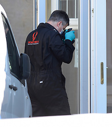 © Licensed to London News Pictures. 03/08/2018. London UK: Police forensics officers at a fire damaged house in Rush Green, east London, where a body of a woman was found. A 50-year-old man was arrested at the scene on suspicion of murder and currently remains in custody at an east London police station.. Photo credit: Steve Poston/LNP