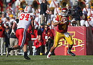 November 06 2010: Iowa State Cyclones quarterback Austen Arnaud (4) looks for a receiver as Nebraska Cornhuskers defensive end Cameron Meredith (34) closes in during the first half of the NCAA football game between the Nebraska Cornhuskers and the Iowa State Cyclones at Jack Trice Stadium in Ames, Iowa on Saturday November 6, 2010. Nebraska defeated Iowa State 31-30.