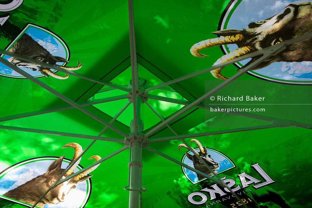 A cafe parasol featuring the Ibex for Slovenian Lasko beer, a Slovenian favourite drink, on 20th June 2018, Dolenji Novaki, Slovenia. Lasko Brewery is the largest brewery in Slovenia and named after the town of Lasko, where it is located. The brewery was founded in 1825 by Franz Geyer, a gingerbread baker and mead producer. After World War II ended in 1945, Lasko was the fifth-largest in Yugoslavia, and by 1991 it was the largest among 28 Yugoslav breweries. It lost much of the Yugoslav market in 1991 after Slovenia declared independence and the resulting Ten-Day War, although sales rebounded during the 1990s. In 2016 Lasko and Union were formally merged into Pivovarna Lasko Union under the owner Heineken.