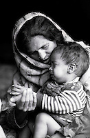 Mother and child in a refugees camp...Jelum Valley 2001