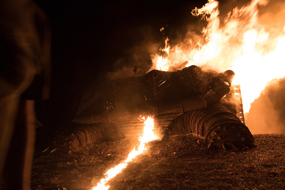 A giant wooden alligator snapping turtle, built by Josh Weidert and his Blood, Sweat and Bonfires in Garyville, set on fire on Christmas eve.<br /> Christmas Eve Bonfires on the Mississippi River Levee are said to be lit to help direct Papa Noel, or Santa Claus down the Mississippi River and into Cajun country.