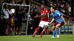 Mark Little of Bristol City passes the ball down the line past Josh Morris of Scunthorpe United - Mandatory by-line: Robbie Stephenson/JMP - 23/08/2016 - FOOTBALL - Glanford Park - Scunthorpe, England - Scunthorpe United v Bristol City - EFL Cup second round