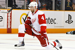 March 3, 2011; San Jose, CA, USA;  Detroit Red Wings defenseman Jakub Kindl (4) warms up before the game against the San Jose Sharks at HP Pavilion.  San Jose defeated Detroit 3-1. Mandatory Credit: Jason O. Watson / US PRESSWIRE