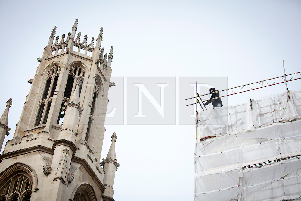 © Licensed to London News Pictures. 28/01/2013. London, UK. A man is seen protesting against an alleged miscarriage of justice on the roof of a building in Fleet Street, London, today (28/01/13). Photo credit: Matt Cetti-Roberts/LNP