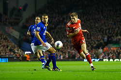 LIVERPOOL, ENGLAND - Tuesday, March 13, 2012: Liverpool's captain Steven Gerrard in action against Everton's Jack Rodwell and Steven Pienaar during the Premiership match at Anfield. (Pic by David Rawcliffe/Propaganda)