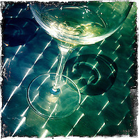 2013 May 13:  White wine glass reflection at Artesa in Carneros. Artesa focuses on producing small, ultra-premium lots of the varietals for which the Carneros and the Napa Valley are best known - Chardonnay, Pinot Noir, Merlot and Cabernet Sauvignon.