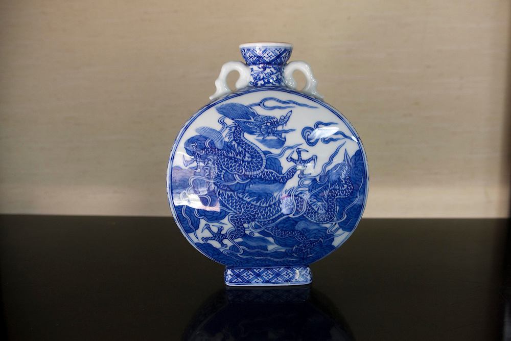 """the Tsuji House has a 350-year history and superb technique for making white porcelain. Since the generation of the one hundred eleventh Emperor Reigen(1664), the Tsuji House has been taking orders for tableware from the Japanese Imperial Household. The House of Tsuji was the first kiln to make white porcelain tableware for imperial use. This distinction can be seen by comparing the other porcelain painters in Arita such as Kakiemon and Imaemon--Kakiemon House is called """"the kiln of the common people"""" and Imaemon House is called """"the kiln of the feudal domain,"""" but Tsuji House is called """"the kiln for the Imperial Household.""""..In the Meiji Era, the Tsuji House continued to make white porcelain tableware for the Imperial Household, to whom they supplied nearly all of their work. Therefore, there was no sign on their works, and only a few pieces were sold to private citizens as they were very difficult to purchase. Tsuji ceramics from this era are therefore extremely prized by collectors...Working for the Imperial Household requires consistent creation of the best porcelain. Compared with """"Somenishiki"""" (porcelain with blue underglaze and enamel overglaze), """"Sometsuke"""" (blue underglazing with cobalt oxide) requires delicate and demanding craftsmanship because the porcelain painters must obtain all artistic effects through the use of a single color, cobalt blue. Sometsuke porcelain has fascinated people all over the world for centuries, and it accounts for a significant percentage of the world's collected porcelain and ceramics due to its popularity. However, very few porcelain painters produce Sometsuke ware at present. Of those who do make Sometsuke, the fourteenth Tsuji, Hitachi Tsuji, is recognised as a superb artist who crafts traditional arts to perfection."""