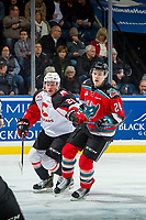 KELOWNA, CANADA - NOVEMBER 29: Jared Bethune #21 of the Prince George Cougars checks Kyle Topping #24 of the Kelowna Rockets on November 29, 2017 at Prospera Place in Kelowna, British Columbia, Canada.  (Photo by Marissa Baecker/Shoot the Breeze)  *** Local Caption ***
