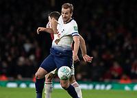 Football - 2018 / 2019 EFL Carabao Cup (League Cup) - Quarter-Final: Arsenal vs. Tottenham Hotspur<br /> <br /> Harry Kane (Tottenham FC)  has his shirst grabbed by Sokratis Papastathopoulos (Arsenal FC) at The Emirates.<br /> <br /> COLORSPORT/DANIEL BEARHAM