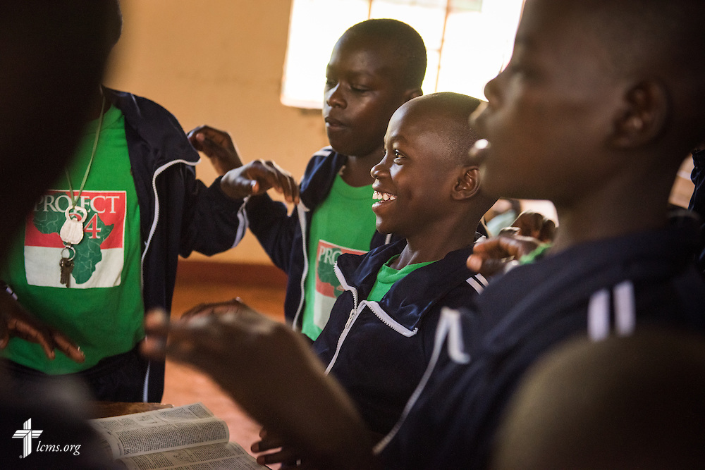 Young men sing during Bible study at the Othoro ELCK (Evangelical Lutheran Church in Kenya) Project 24 boarding facility on Sunday, Oct. 18, 2015, in Kisumu, Kenya. LCMS Communications/Erik M. Lunsford
