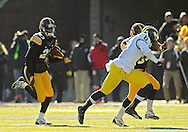 November 23 2013: Iowa Hawkeyes wide receiver Jordan Cotton (23) returns a kick during the second quarter of the NCAA football game between the Michigan Wolverines and the Iowa Hawkeyes at Kinnick Stadium in Iowa City, Iowa on November 23, 2013. Iowa defeated Michigan 24-21.