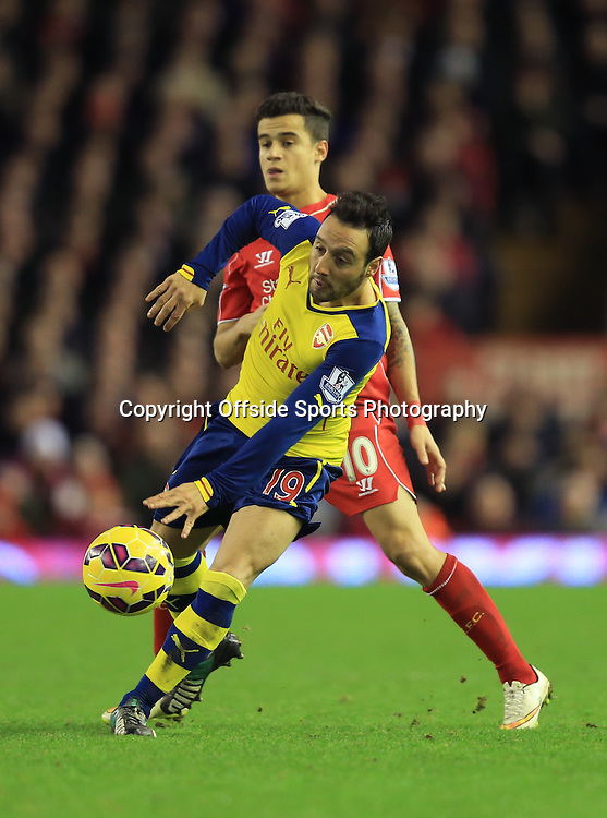 21 December 2014 - Barclays Premier League - Liverpool v Arsenal - Santi Cazorla of Arsenal tangles with Philippe Coutinho of Liverpool - Photo: Marc Atkins / Offside.