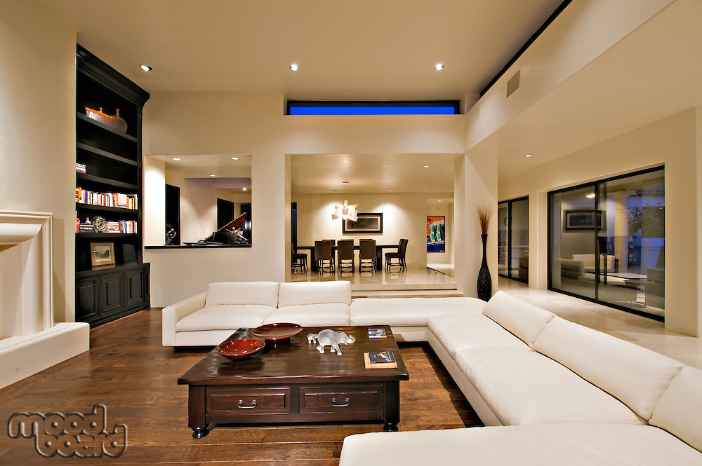 Contemporary living room on hardwood floor in mansion
