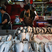Fishmonger at Khlong Toei market, Bangkok