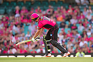 Sydney Sixers player Daniel Hughes hits the ball at the Big Bash League cricket match between Sydney Sixers and Melbourne Stars at The Sydney Cricket Ground in Sydney, Australia