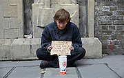 A homeless man begging for money on Tooley Street, Central London.