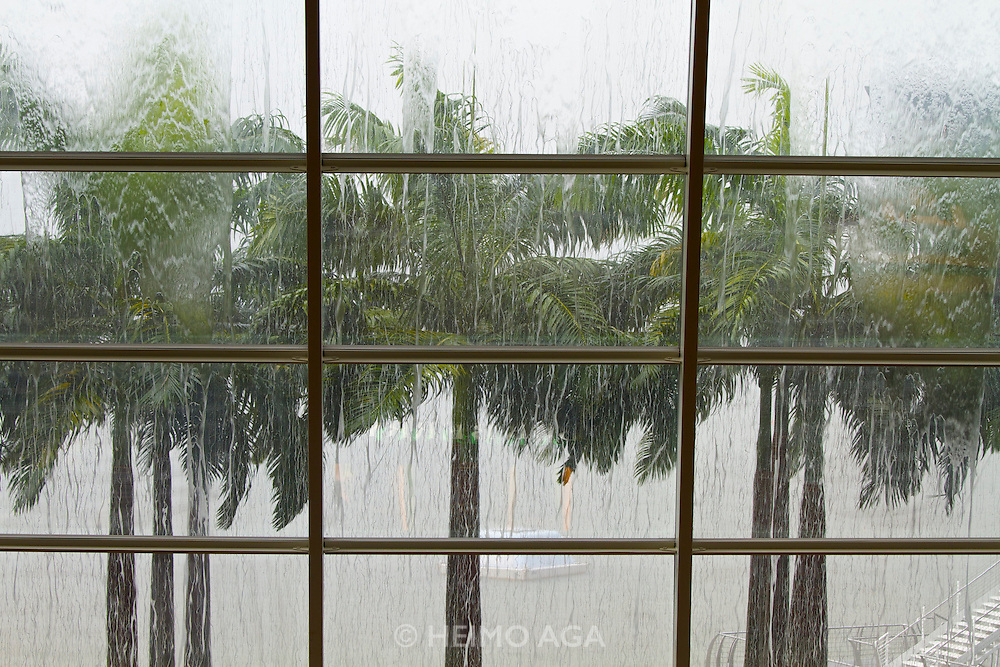 Singapore. Marina Bay Sands. SANTI restaurant combines Mediterranean culture with the authentic taste of the Catalan region in Spain..Rain seen through the windows of the Mall.