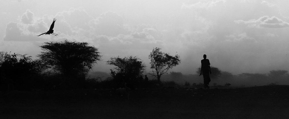 A young man walk through a dust storm in Dadaab, Kenya September 14, 2006. ..Photograph by Erin Lubin