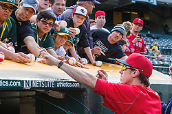 OAKLAND, CA - JUNE 17:  Tim Lincecum #55 of the Los Angeles Angels of Anaheim signs autographs before the game against the Oakland Athletics at the Oakland Coliseum on June 17, 2016 in Oakland, California. The Oakland Athletics defeated the Los Angeles Angels of Anaheim 3-2. (Photo by Jason O. Watson/Getty Images) *** Local Caption *** Tim Lincecum
