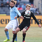 NEW YORK, NEW YORK - March 12:  Jared Jeffrey #25 of D.C. United challenged by Andrea Pirlo #21 of New York City FC during the NYCFC Vs D.C. United regular season MLS game at Yankee Stadium on March 12, 2017 in New York City. (Photo by Tim Clayton/Corbis via Getty Images)