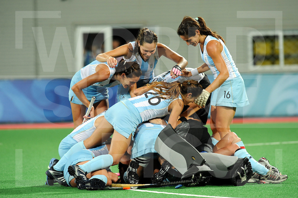 Argentina celebrate  winning the Bronze Medal over Germany in the Womens Hockey, Bronze medal Game Argentina Vs Germany 22-8-08 at the ..Beijing Olympic Green Hockey Stadium , Beijing Olympics ..Photo: Grant Treeby/WSP