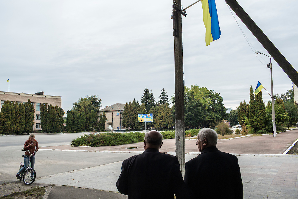 SEMYONOVKA, UKRAINE - SEPTEMBER 13, 2015: Ivan Kovalenko, 69, left, and Ivan M. Papchenko, 67, the secretary of the local Communist party, at the edge of Red Square in Semyonovka, Ukraine. A statue of Vladimir I. Lenin, which was taken down from the square in the immediate aftermath of the collapse of the government of President Viktor Yanukovych in February 2014, was erected again in a new, more discreet, location in a park two months later based in part by a petition to the city council submitted by the local Communist party. A new decommunization law has stirred criticism as being a diversion from more pressing issues of war and the economy. CREDIT: Brendan Hoffman for The New York Times