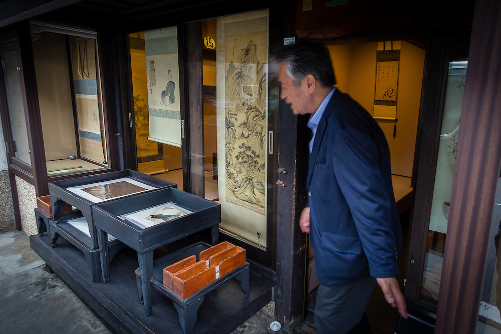 Mr. Yamazoe opens up his antique scroll shop in Kyoto.