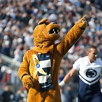 "The Penn State Nittany Lion mascot leads the ""We Are, Penn State"" chant prior to a game against the Illinois Fighting Illini on November 2, 2013 at Beaver Stadium in University Park, Pennsylvania."