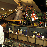 A man looks at a display of faux Crown Jewls of England on display at a Washington, DC area JC Penney store during the November 1985 visit of the Prince and Princess of Wales to the U.S.