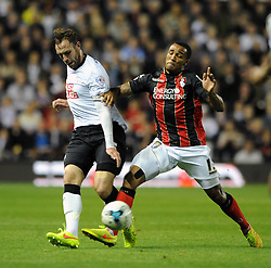 Derby County's Richard Keogh challenges for the ball with  <br /> Bournemouth's Callum Wilson - Photo mandatory by-line: Dougie Allward/JMP - Mobile: 07966 386802 - 30/09/2014 - SPORT - Football - Derby - Pride Park - Derby County v AFC Bournemouth - Sky Bet Championship