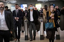 © Licensed to London News Pictures. 10/03/2020. London, UK. A commuter wearing a medical mask at Westminster Underground Station in central London. New cases of the COVID-19 strain of Coronavirus are being reported daily as the government outlines it's plans for controlling the outbreak. Photo credit: Ben Cawthra/LNP