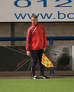 Dundee goalkeeping coach Bobby Geddes runs the line after referee Willie Fergusn went off injured - Dundee v Hearts in the SPFL Development League at Links Park in  Montrose : Image &copy; David Young<br /> <br />  - &copy; David Young - www.davidyoungphoto.co.uk - email: davidyoungphoto@gmail.com
