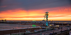 © Licensed to London News Pictures. 27/12/2017. Brighton, UK. A colourful sky behind the Brighton Palace Pier as the sun sets over Brighton and Hove. Photo credit: Hugo Michiels/LNP