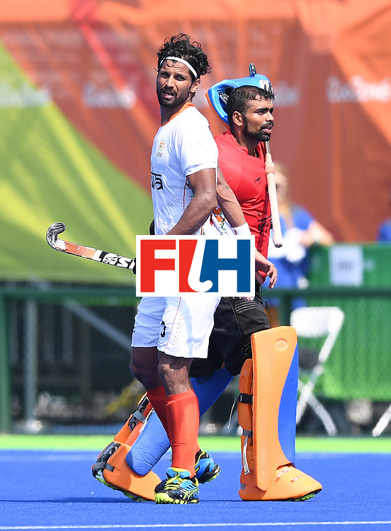 India's Sreejesh Parattu (R) and India's Rupinder Pal Singh walk past each other after the men's field hockey Argentina vs India match of the Rio 2016 Olympics Games at the Olympic Hockey Centre in Rio de Janeiro on August, 9 2016. / AFP / MANAN VATSYAYANA        (Photo credit should read MANAN VATSYAYANA/AFP/Getty Images)
