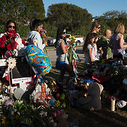 Well wishers place mementos the day when students and parents came for campus orientation at the Marjory Stoneman Douglas high school for reopening following last week's mass shooting in Parkland, Florida, U.S., February 25, 2018. Attendance was voluntary but hundreds of students and parents showed up. The school opens this coming Wednesday. Seventeen persons including students and staff were murdered in the shooting. REUTERS/Angel Valentin