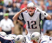 Dec 1, 2013; Houston, TX, USA; New England Patriots quarterback Tom Brady (12) signals against the Houston Texans during the first half at Reliant Stadium. Mandatory Credit: Thomas Campbell-USA TODAY Sports