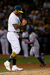 OAKLAND, CA - SEPTEMBER 21:  Danny Santana #38 of the Texas Rangers rounds the bases after hitting a home run off of Sean Manaea #55 of the Oakland Athletics during the sixth inning at the RingCentral Coliseum on September 21, 2019 in Oakland, California. The Oakland Athletics defeated the Texas Rangers 12-3. (Photo by Jason O. Watson/Getty Images) *** Local Caption *** Danny Santana; Sean Manaea