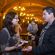 FEBRUARY 19, 2018--MIAMI, FLORIDA-<br /> Attendees interact in the lobby of the Olympia Theater in downtown Miami during the opening reception for the Knight Media Forum.<br /> (Photo by Angel Valentin)