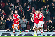 Dani Ceballos (Arsenal) celebrates his goal with Kieran Tierney (Arsenal) looked on by Shkodran Mustafi (Arsenal) during the Europa League match between Arsenal and Standard Liege at the Emirates Stadium, London, England on 3 October 2019.