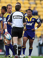 Jimmy Cowan (ball in hand) looks on, confused at an umpiring decision. Super 15 - Hurricanes v Highlanders, Westpac stadium, Wellington, 18 February 2011. PHOTO: Grant Down / photosport.co.nz