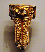 Group of Frankish objects, some decorated with garnet cloisonne, believed to be from a double male and female burial. The similarity between these objects and those from Finglesham reveals close ties between France and Kent in this period. The Franks were a West Germanic tribal confederation in the third century AD as living north and east of the Lower Rhine River. From the third to fifth centuries some Franks raided Roman territory while other Franks joined the Roman troops in Gaul.