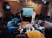 "Liveboard conference. Computer scientists use an interactive liveboard - a wall-sized, touch- sensitive computer screen - during a conference in the ""beanbag room"" at Xerox PARC (Palo Alto Research Center), California. The liveboard is one of the company's most recent innovations. One of Silicon Valley's most visionary computer companies, Xerox PARC is the birthplace of the computer workstation, the mouse and the ""graphical user interface"" - the now universal system of interacting with computers through windows and icons.."