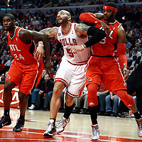 04 May 2011: Chicago Bulls power forward Carlos Boozer (5) vies for the rebound with Atlanta Hawks small forward Marvin Williams (24) and Atlanta Hawks power forward Josh Smith (5) during the Chicago Bulls 86-73 victory over the Atlanta Hawks, during game 2 of the Eastern Conference semi finals at the United Center, Chicago, Illinois, USA.