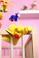 Crib with toys focus on foreground