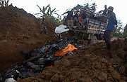 Banda Aceh, Indonesia<br />Following the devestating Tsunami, Indonesia comes to terms with the scale of destruction.<br />Given the scale of the disaster, the authorities face the gruesome task of burying the dead in mass graves.