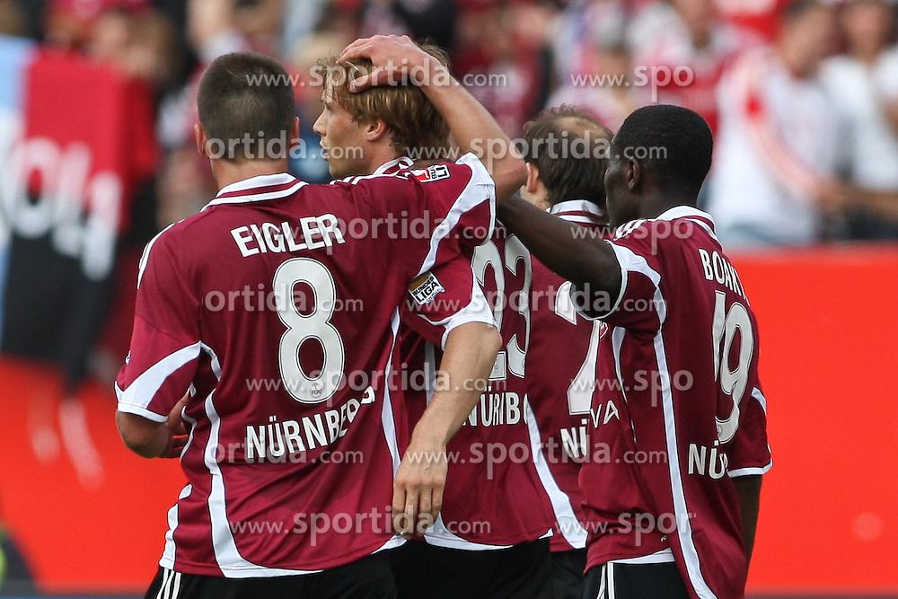 08.05.2010, easyCredit Stadion, Nuernberg, GER, 1. FBL, 1 FC Nuernberg vs 1 FC Koeln, im Bild: .Andreas Ottl (Nuernberg #23) macht das 1:0 und jubelt mit Christian Eigler (Nuernberg #8) sowie Isaac Boakye (Nuernberg #19).EXPA Pictures © 2010, PhotoCredit: EXPA/ nph/  news / SPORTIDA PHOTO AGENCY
