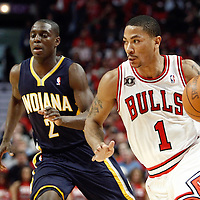 16 April 2011:  Chicago Bulls point guard Derrick Rose (1) drives past Indiana Pacers point guard Darren Collison (2) during the Chicago Bulls 104-99 victory over the Indiana Pacers, during the game 1 of the Eastern Conference first round at the United Center, Chicago, Illinois, USA.