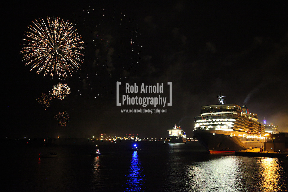 © Rob Arnold.  09/05/2014. Southampton, UK. Firework celebrations marking the 10-year anniversary of the Cunard flagship, Queen Mary 2, take place in the port of Southampton this evening, 9th May 2014. All 'three queens' of the Cunard fleet were present at the event, which included a 10-minute firework display, one minute for every year that the QM2 has been in service.. Photo by Rob Arnold