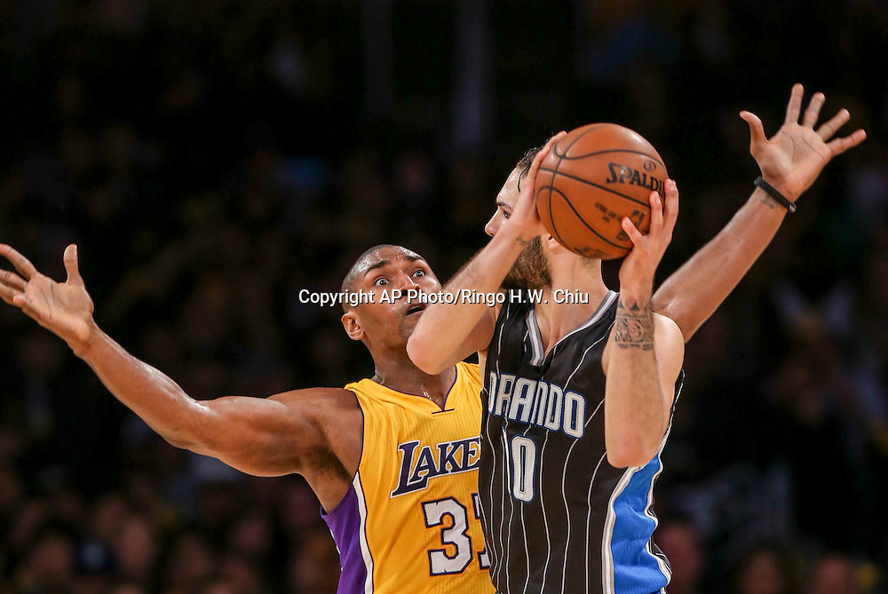 Orlando Magic forward Evan Fournier (10) and Los Angeles Lakers forward Metta World Peace (37) in actions during the second half of an NBA basketball game Tuesday, March 8, 2016, in Los Angeles.  Lakers won 107-98. (AP Photo/Ringo H.W. Chiu)