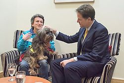 © Licensed to London News Pictures. 19/01/2015. London, UK Marian Janner, founder of Star Wards, a mental health website  with her service dog Buddy. Deputy Prime Minister Nick Clegg and the Minister of State for Care and Support, Norman Lamb, host a mental health conference on Monday 19 January 2015 at The King's Fund London. Photo credit : Stephen Simpson/LNP